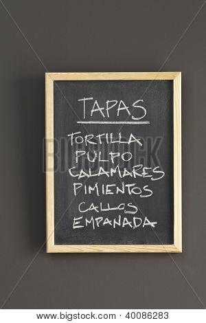 Tapas Advertised On A Blackboard
