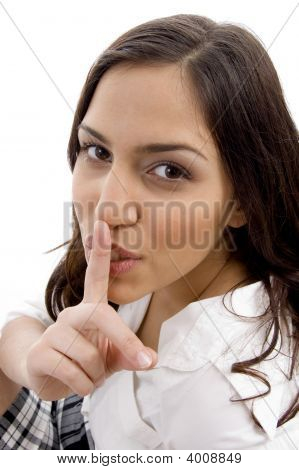 Young Woman Shushing With Hand Gesture