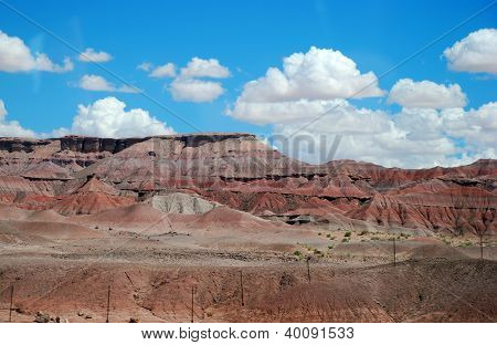 red cliffs, plateaus of Arizona and a blue sky with clouds