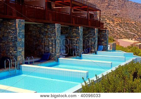 Summer Resort With Row Of Private Swimming Pools