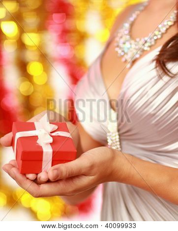 Young beautiful woman with christmas gift,isolatded christmas decoration.focus on gift