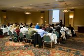 image of training room  - Hotel conference room full of people participating in the business training - JPG