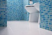 stock photo of lavabo  - Blue bathroom closeup with little tiles mosaic - JPG