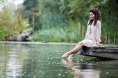 pic of wet feet  - Young woman relaxing on the calm lake - JPG