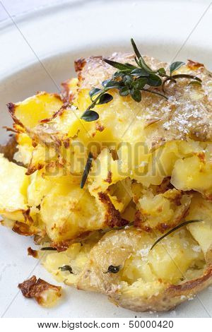 Crushed roast potatoes with sea salt flakes, rosemary and thyme.