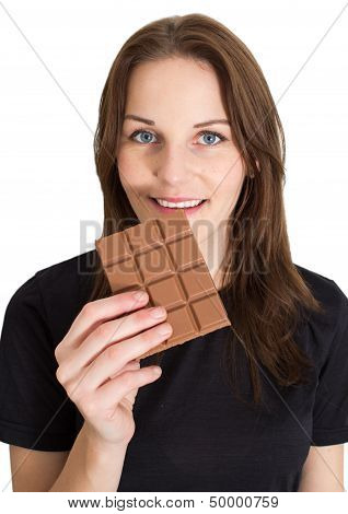 Woman Eating Chocolate And Smiling