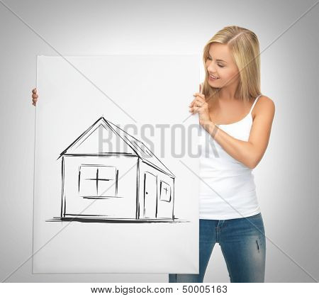 real estate, property, business and accomodation concept - woman holding picture with house