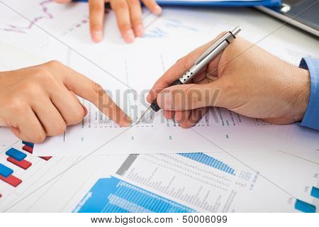 Man filling a quality survey with check boxes