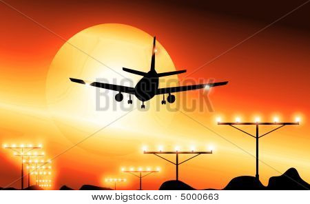 Airplane Landing At Sunset