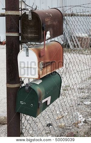 Three old mailboxes