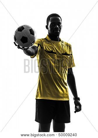 one african man referee  standing holding showing football in silhouette  on white background