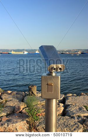 Metallic Coin Operated Viewer For Tourists To Look At Against Coastal. Including Clipping Path
