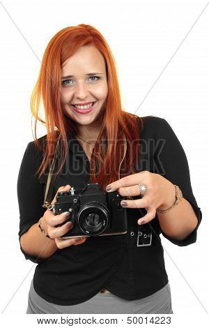 Smiling young woman with old camera