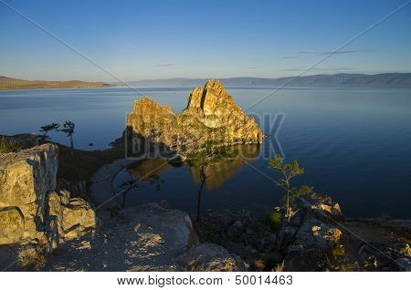 Shaman Rock In The Rays Of The Rising Sun. Olkhon Island, Baikal, Russia.