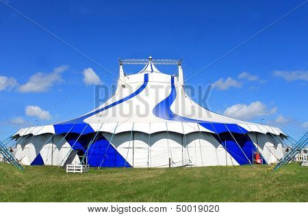 Circus big top tent in summer, blue sky background.