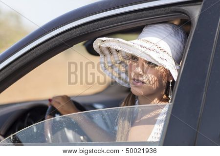 young woman is in a car