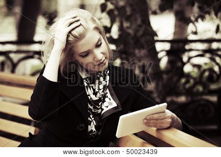 Young woman holding a digital tablet computer