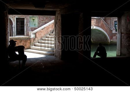 Street Musician And Lonely Figure In The Shadows Of Venice