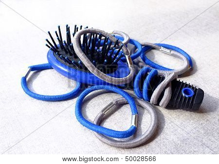 Elastic hair bands and a hair brush