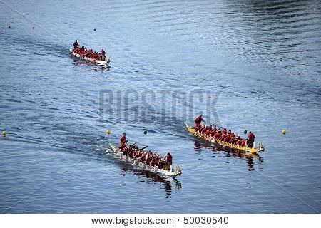 HARTFORD - AUGUST 17: Racers participate in a dragon boat race during the annual Riverfront Dragon Boat & Asian Festival August 17, 2013 in Hartford, CT.