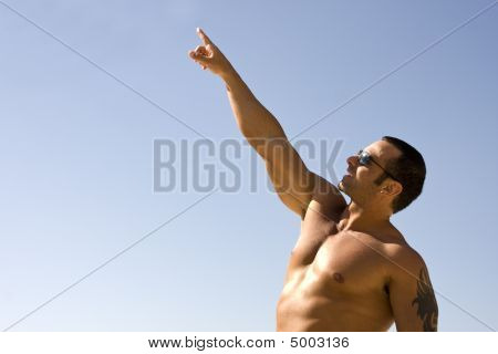 Young Muscular Male Pointing At Sky