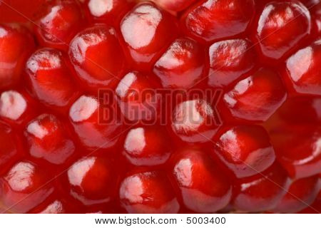 Macro Of Ripe Seeds Pomegranate Isolated
