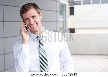 Portrait Of A Handsome Young Businessman On Phone