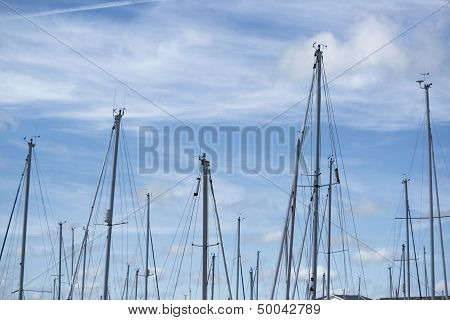 Blue Summer Sky With Masts From Yacht Sailboats