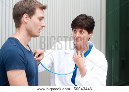 Portrait Of Female Doctor With Patient