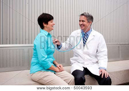 Mature Doctor With Female Patient