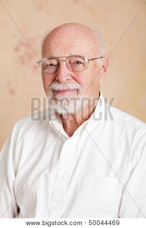 Portrait of a serious senior man with glasses.