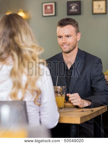 Handsome young business man with female colleague at coffeeshop