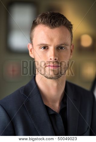Portrait of handsome young businessman at coffeeshop