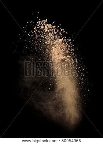 Freeze motion of white dust explosion isolated on black background
