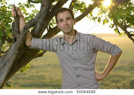 Man under tree on field
