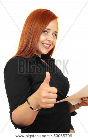 Beautiful redhead business woman with thumbs up, showing everything is OK