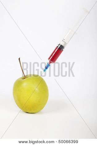 Granny smith apple being injected over white background