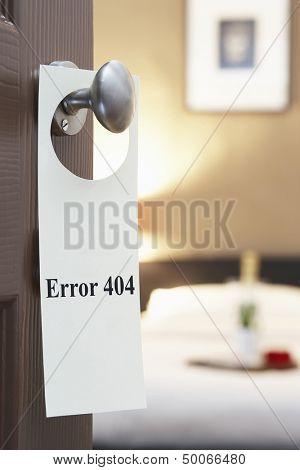 Error 404' sign on hotel room door