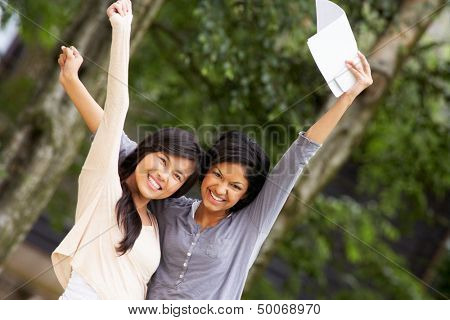 Two Teenage Girls Celebrating Successful Exam Results