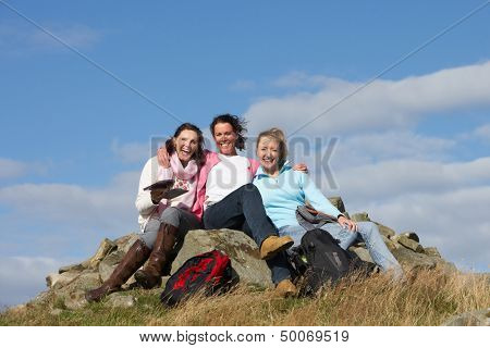 Group Of Women Stopping For Lunch On Countryside Walk