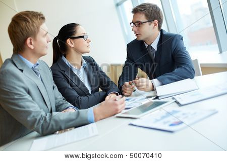 Elegant entrepreneurs meeting in office to discuss business matters
