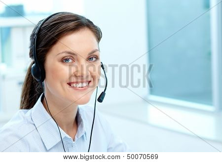 Portrait of a friendly-looking girl providing online service