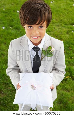Page Boy Carrying Wedding Ring On Cushion