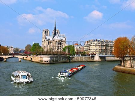Passenger cruise at Cathedral Notre Dame, river Seine Paris France