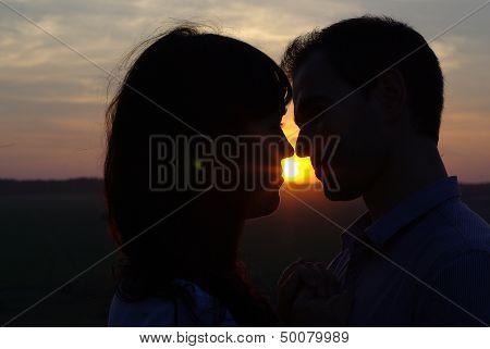 Silhouette couple at sunset