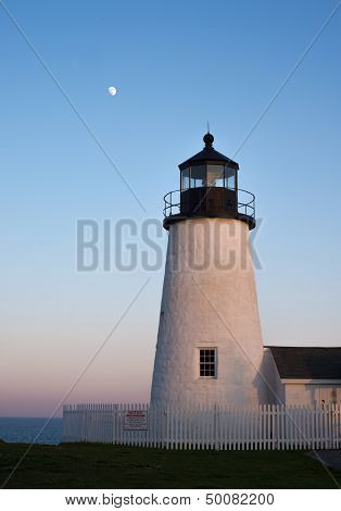 Moonrise over lighthouse