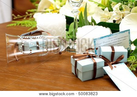 Beautiful designer wedding accessories on table .