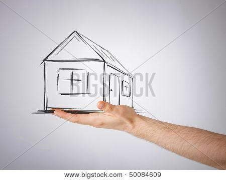 real estate, technology and accomodation concept - picture of house on virtual screen in man hand