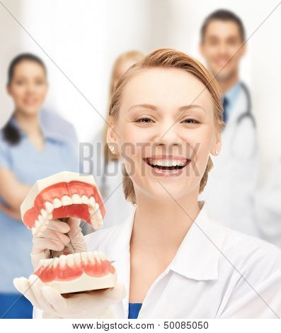 healthcare, medical and stomatology concept - attractive female doctor with big jaws