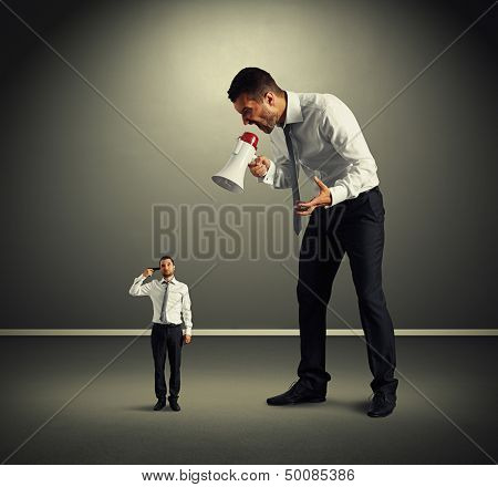 big man screaming at small man with gun